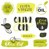 Vector hand lettering olive production logos or signs. Retro sketched extra virgin oil illustrations set for farm or cosmetics pr. Oduce, packaging badges, tags vector illustration