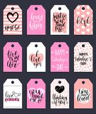 Vector hand lettering phrases Fall In Love etc.on labels or tags. February 14 calligraphy set.Valentines day typography. Vector hand lettering phrases You Are Royalty Free Stock Images