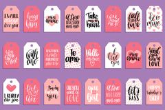 Vector hand lettering phrases Fall In Love etc.on labels or tags. February 14 calligraphy set.Valentines day typography. Vector hand lettering phrases You Are Royalty Free Stock Photo