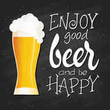 Vector hand lettering quote - enjoy good beer and be happy - with flat glass of beer with fluffy foam on blackboard Stock Image