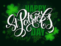 Vector hand lettering saint patricks day greetings card with clover shapes and branches Stock Images