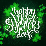 Vector hand lettering saint patricks day greetings card with clover shapes and branches Stock Photography