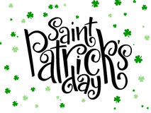 Vector hand lettering saint patricks day greetings text with clover shapes Royalty Free Stock Images