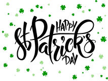 Vector hand lettering saint patricks day greetings text with clover shapes Stock Photography