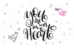 Vector hand lettering valentine`s day greetings text - you are in my heart - with heart shapes and birds.  Stock Photo