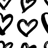 Vector hand-painted seamless pattern with ink hearts. Abstract background. Doodles. Stock Photos