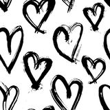 Vector hand-painted seamless pattern with ink hearts. Abstract background. Doodles. Stock Photography