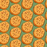 Vector hand painted  seamless pattern with orange persimmon cut in half on green background.Perfect for wallpaper, wrapping paper, Stock Photography