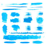 Vector handmade blue strokes set painted by brush Stock Photos