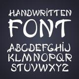 Vector handwritten brush font. White letters on chalkboard background.  Stock Photo