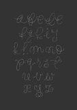 Vector handwritten brush script. White letters on black background. Vector handwritten brush script. White letters on chalkboard background Stock Images