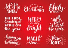 Vector handwritten Christmas and New Year calligraphy set with fest decorations.Happy Holidays,Holly Jolly etc lettering. Vector handwritten Christmas and New Royalty Free Stock Photography