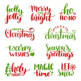 Vector handwritten Christmas and New Year calligraphy set with fest decorations.Happy Holidays,Holly Jolly etc lettering. Vector handwritten Christmas and New Stock Photo