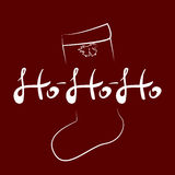 Vector handwritten text HOHOHO and the silhouette of Christmas stocking. Vector illustration. Royalty Free Stock Photos
