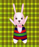 Vector of Happy Bunny. On green background Royalty Free Stock Photos