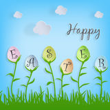 Vector Happy Easter text in easter eggs on nature background for Pascha holiday greeting card. Stock Images