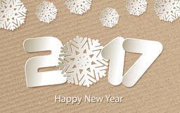 Vector Happy New Year 2017 background with paper cuttings. Happy New Year 2017. Numbers and snowflake cut from paper. Vector Illustration Stock Photo