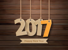 Vector 2017 happy new year paper hanging on wood. 2017 happy new year paper hanging on wood texture background, Vector illustration layout template design stock illustration