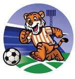 Happy tiger kid playing soccer Royalty Free Stock Image