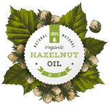Vector hazelnut oil label. Hazelnut oil paper label over hand drawn hazel nuts and leaves. Vector illustration Royalty Free Stock Images