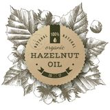 Vector hazelnut oil label. Hazelnut oil paper label over hand drawn hazel nuts and leaves. Vector illustration Royalty Free Stock Photography