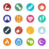 Vector Health And Fitness Icons Within Circles Collection. Collection of vector illustrations of various health and fitness icons within circles in two Stock Photos