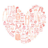 Vector heart of different women's clothes and accessories Stock Image