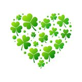 Vector heart made of bright green shamrocks or clovers. Heart made of bright green small shamrocks or clovers on white background. Vector Saint Patricks Day Royalty Free Stock Photography