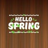 Vector hello de lentebanner met tekst en bloemen hello de lenteslogan of etiket op houten achtergrond wordt geïsoleerd die Royalty-vrije Stock Foto