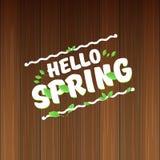 Vector hello de lentebanner met tekst en bloemen hello de lenteslogan of etiket op houten achtergrond wordt geïsoleerd die Royalty-vrije Stock Fotografie