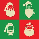 Vector hipster santa silhouette with glasses. Four hipster santa silhouettes with glasses on a colored background Royalty Free Stock Images