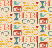 Vector hipster seamless pattern with fashion sunglasses, camera, retro bicycle, comb, bow, pipe etc.in trendy flat style Stock Image