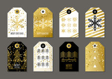 Vector holiday gift tags and outline label set with golden textu Royalty Free Stock Image