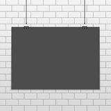 Vector horizontal poster mockup. Black horizontal poster mock up on white brick wall. Empty dark A4 sized vector sheet of paper hanging with paper clips Stock Photo