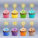 Birthday cupcakes icons. Vector icon set - colorful birthday cupcakes with candles. EPS10 Stock Photos