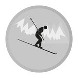 Vector icon skier. A man riding down the hills on skis Stock Photography