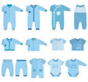 Vector icons of baby clothes for boys. Set children`s clothes for baby boys in flat style. Collection of  clothing on white background. Vector illustration Royalty Free Stock Photography