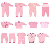 Vector icons of baby clothes for girls. Set children`s clothes for baby girls in flat style. Collection of  clothing on white background. Vector illustration Royalty Free Stock Image