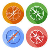 Vector icons depicting four different compasses Royalty Free Stock Photos