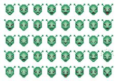 Vector icons of smiley alien faces. Vector icons of smiley pixel alien faces Royalty Free Stock Images