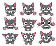 Vector icons of smiley cat faces with paws. Smiley cat faces with paws. Set of vector icons Royalty Free Stock Images