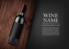 Advertising banner.A realistic bottle of red wine with black label in photorealistic style on wooden dark board,black. Vector illustration.Advertising banner.A Stock Image