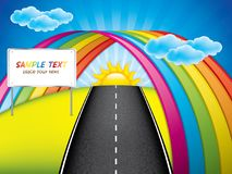 Spring landscape with rainbow over the road and road sign Royalty Free Stock Image