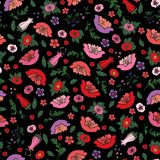 Vector illustration of beautiful seamless texture of poppies and tulips on the black background. stock illustration