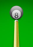Vector illustration of a billiard ball with stick. On green table background vector illustration
