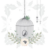 Vector illustration of a bird cage with flower wreaths Stock Photography