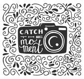 Vector illustration with photo camera and lettering. Vector illustration in black and white color with lettering Catch the moment. Photo camera silhouette, hand Stock Image