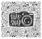 Vector illustration with a photo camera and lettering. Vector illustration in black and white color with lettering Take a snap. Photo camera silhouette, hand Stock Photo