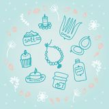 Painted female tricks. Beads, comb, mirror, powder, candle, bath salt, capkake, cosmetics. Vector illustration on a blue backgroun. Vector illustration on a blue Royalty Free Stock Image