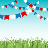 Vector illustration of Blue sky and green grass landskape  with colorful flags garlands. Royalty Free Stock Photography